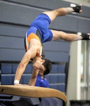 San Angelo Central's Mariano Deller competes on vault during Day 2 of the Texas High School State Gymnastics Championships in Bryan Saturday, April 27, 2019.