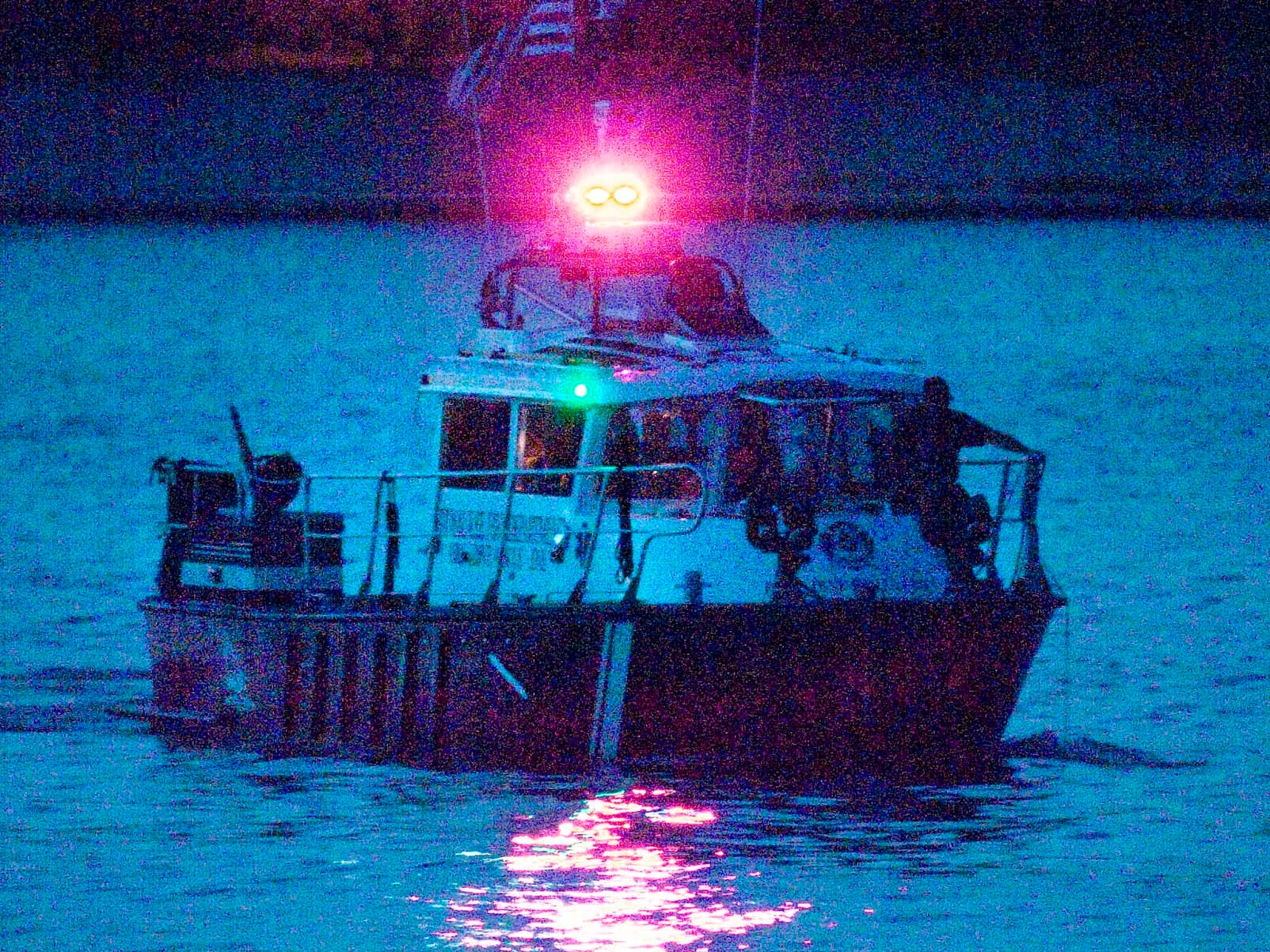Rescue officials scan the waters of the Sheboygan, Wis. lakefront into the evening on Aug. 11, 2008, for John Duong. Duong, 15, of 2623 N. 36th St., was swept underwater by high waves two days earlier while swimming with four friends at North Beach at Deland Park.   FILE PHOTO