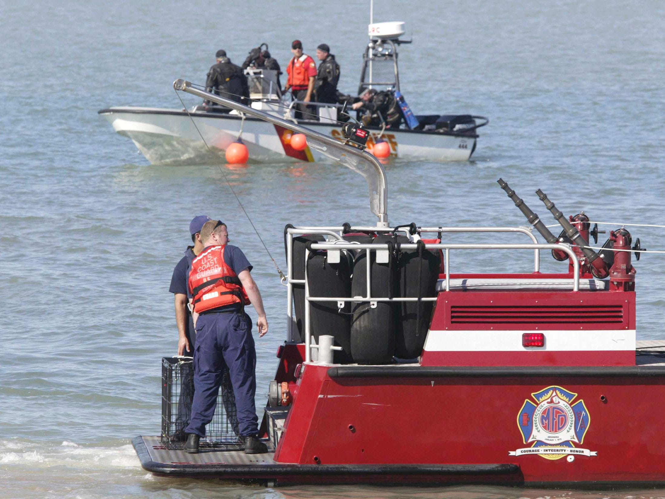 Rescue officials scan the waters of the Sheboygan, Wis., lakefront Aug. 11, 2008, for John Duong. Duong, 15, of 2623 N. 36th St., was swept underwater by high waves Saturday afternoon while swimming with four friends at North Beach at Deland Park.  FILE PHOTO