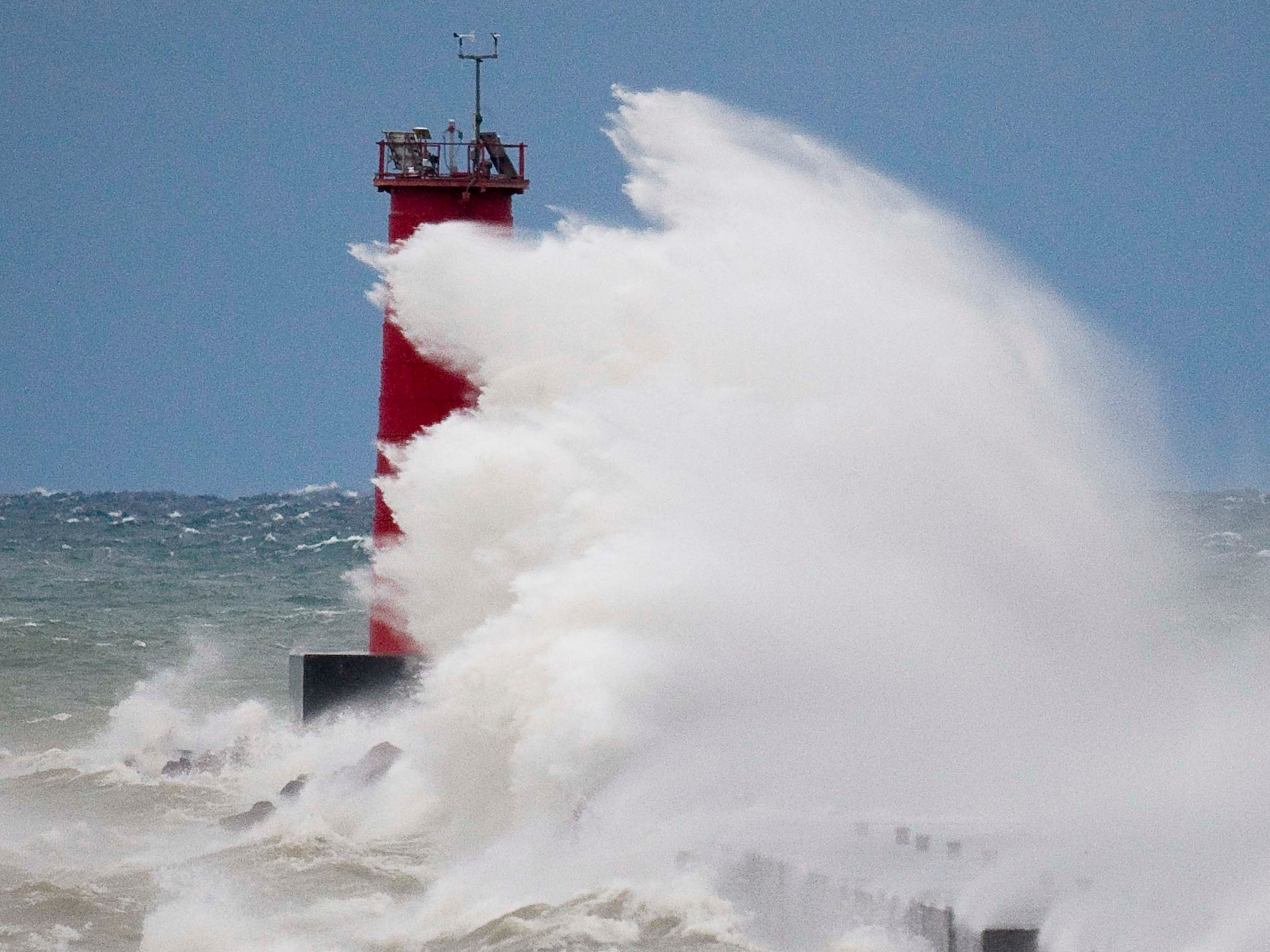 Strong winds blow waves taller than the Sheboygan lighthouse Oct. 19, 2011, in Sheboygan, Wis.  FILE PHOTO
