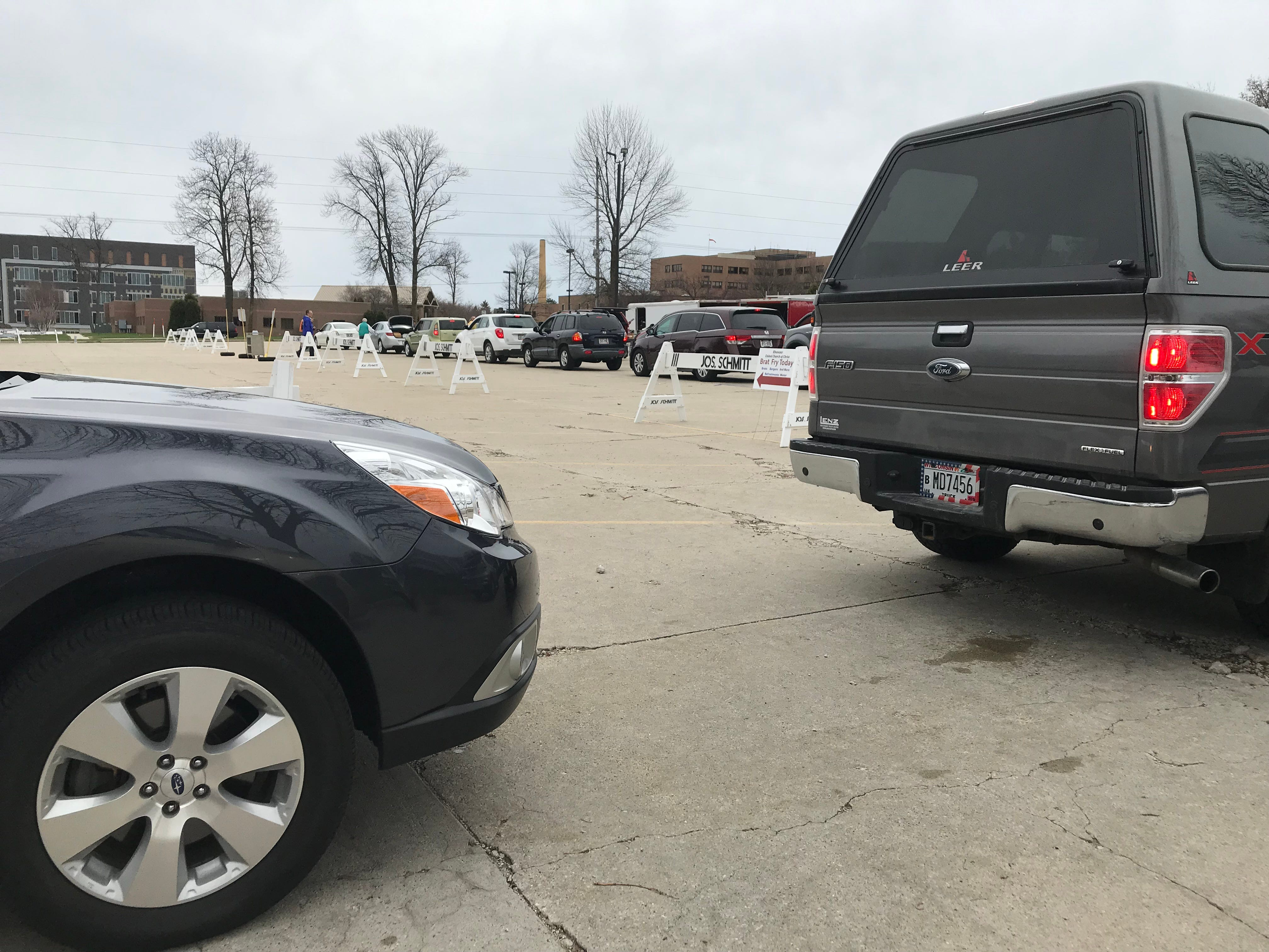 Motorists line up to recycle electronics at Ebenezer United Church of Christ, Saturday, April 27, 2019, in Sheboygan, Wis.