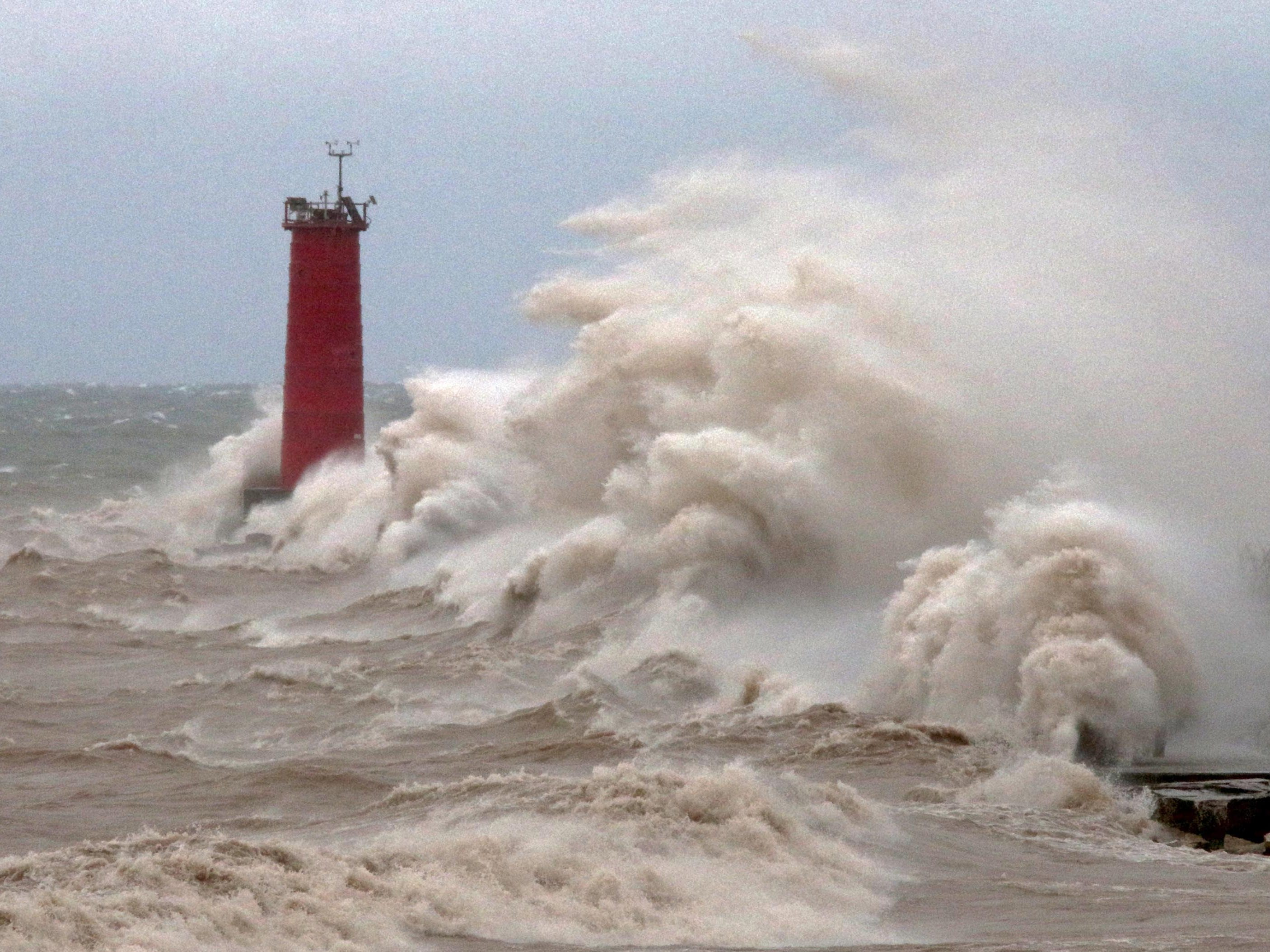 Strong winds whipped waves against the Sheboygan north pier breakwater, on April 14, 2018, in Sheboygan, Wis. According to the National Weather Service, 52 mph winds were recorded at Sheboygan Memorial Airport.  FILE PHOTO