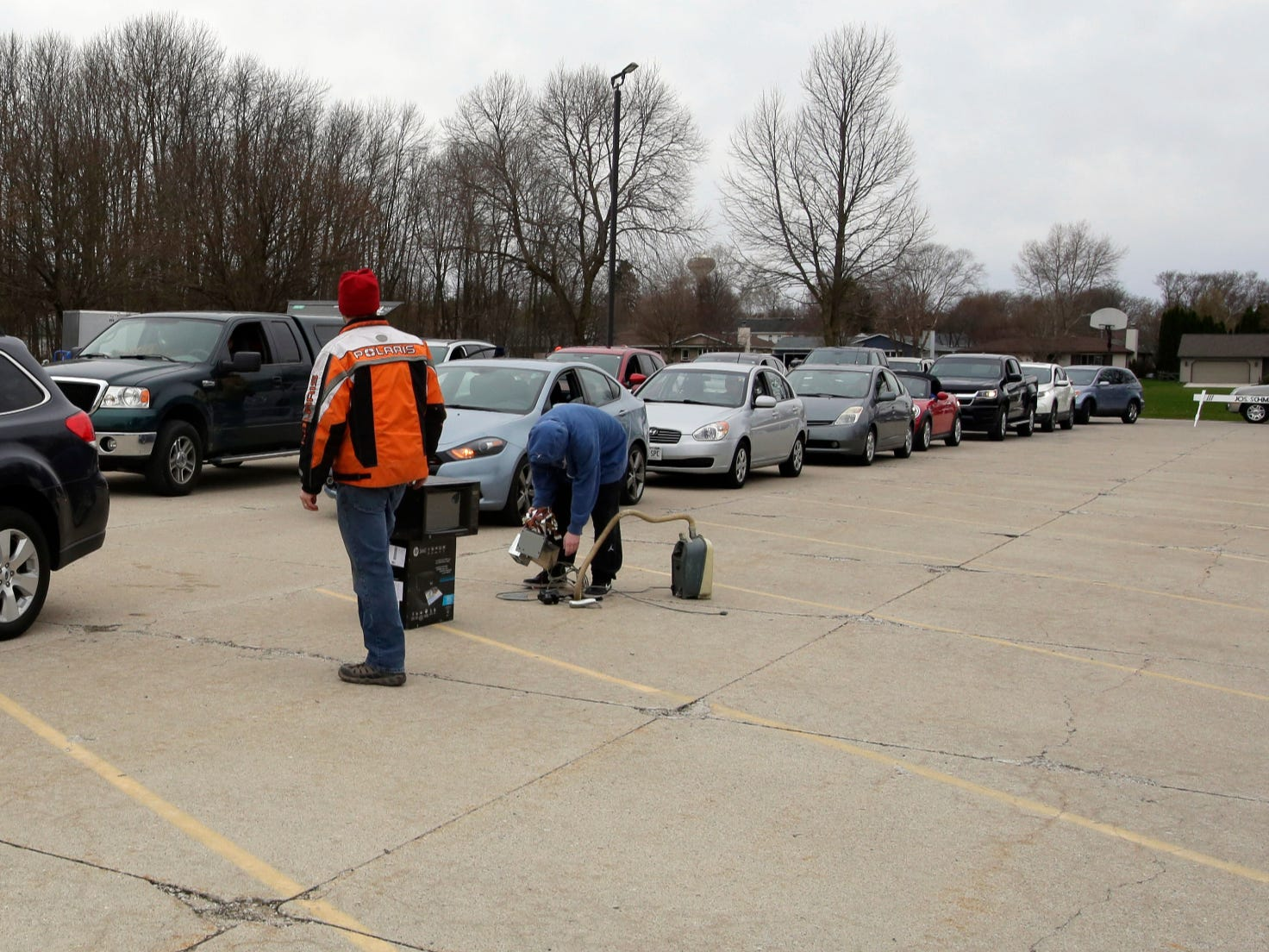 Electronics to be recycled are taken out of vehicles during a recycling event at Ebenezer United Church of Christ, Saturday, April 27, 2019, in Sheboygan, Wis.