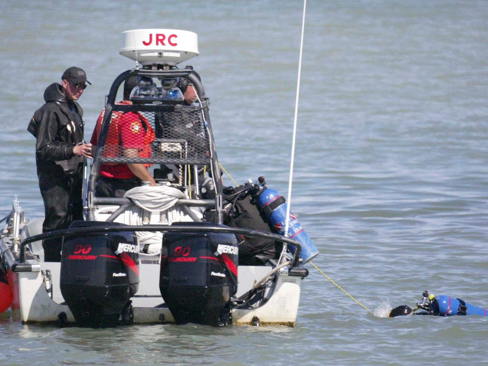 Scuba divers look for John Duong on Aug. 11, 2008, at the Sheboygan lakefront. Duong, 15, of 2623 N. 36th St., was swept underwater by high waves Aug. 9 while swimming with four friends at North Beach at Deland Park, in Sheboygan, Wis.  FILE PHOTO