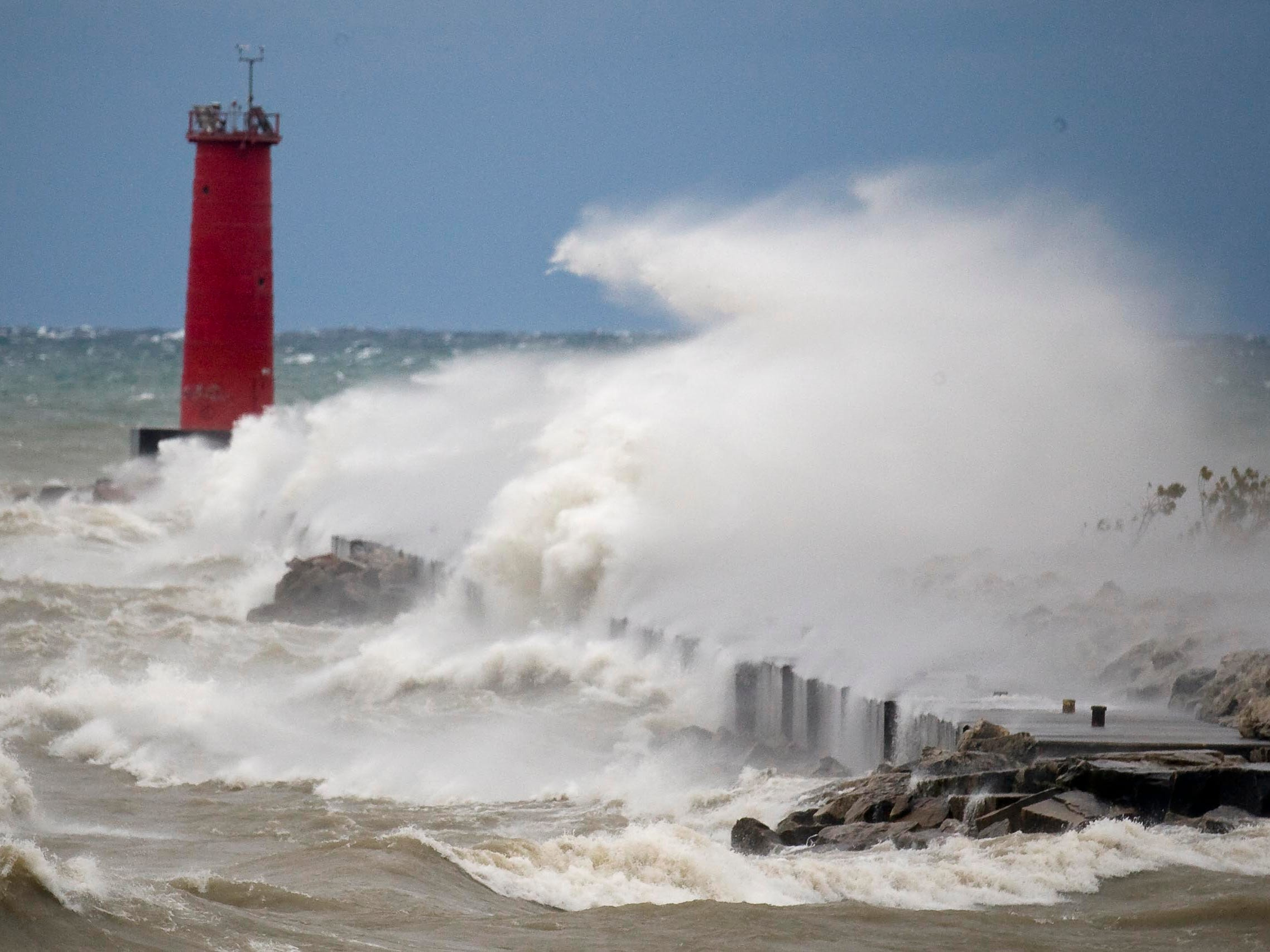 Strong winds blow waves nearly as tall as the Sheboygan lighthouse on Oct. 19, 2011, in Sheboygan, Wis.  FILE PHOTO