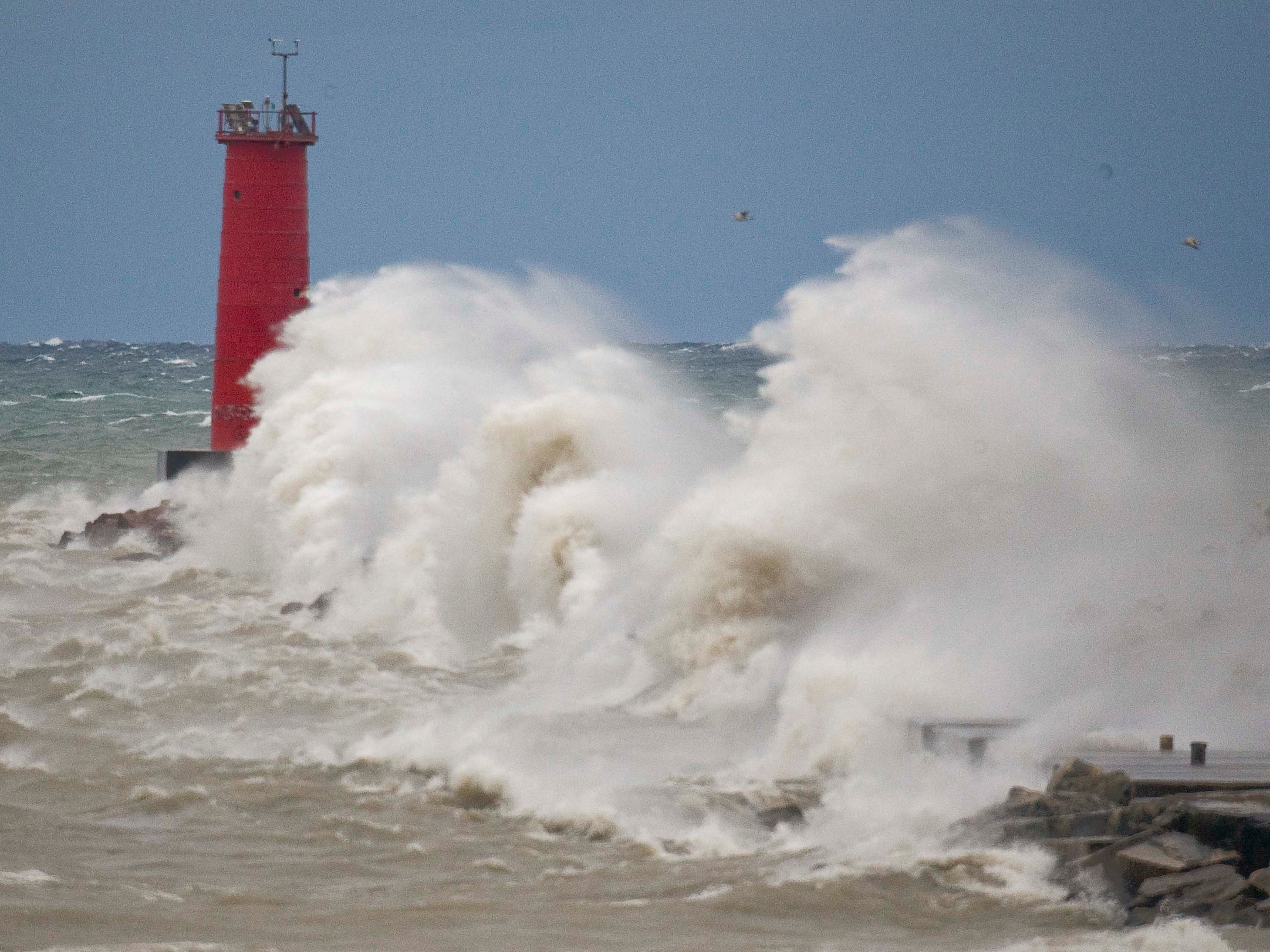 Strong winds blow nearly as tall as the Sheboygan lighthouse Oct. 19, 2011, in Sheboygan, Wis. FILE PHOTO