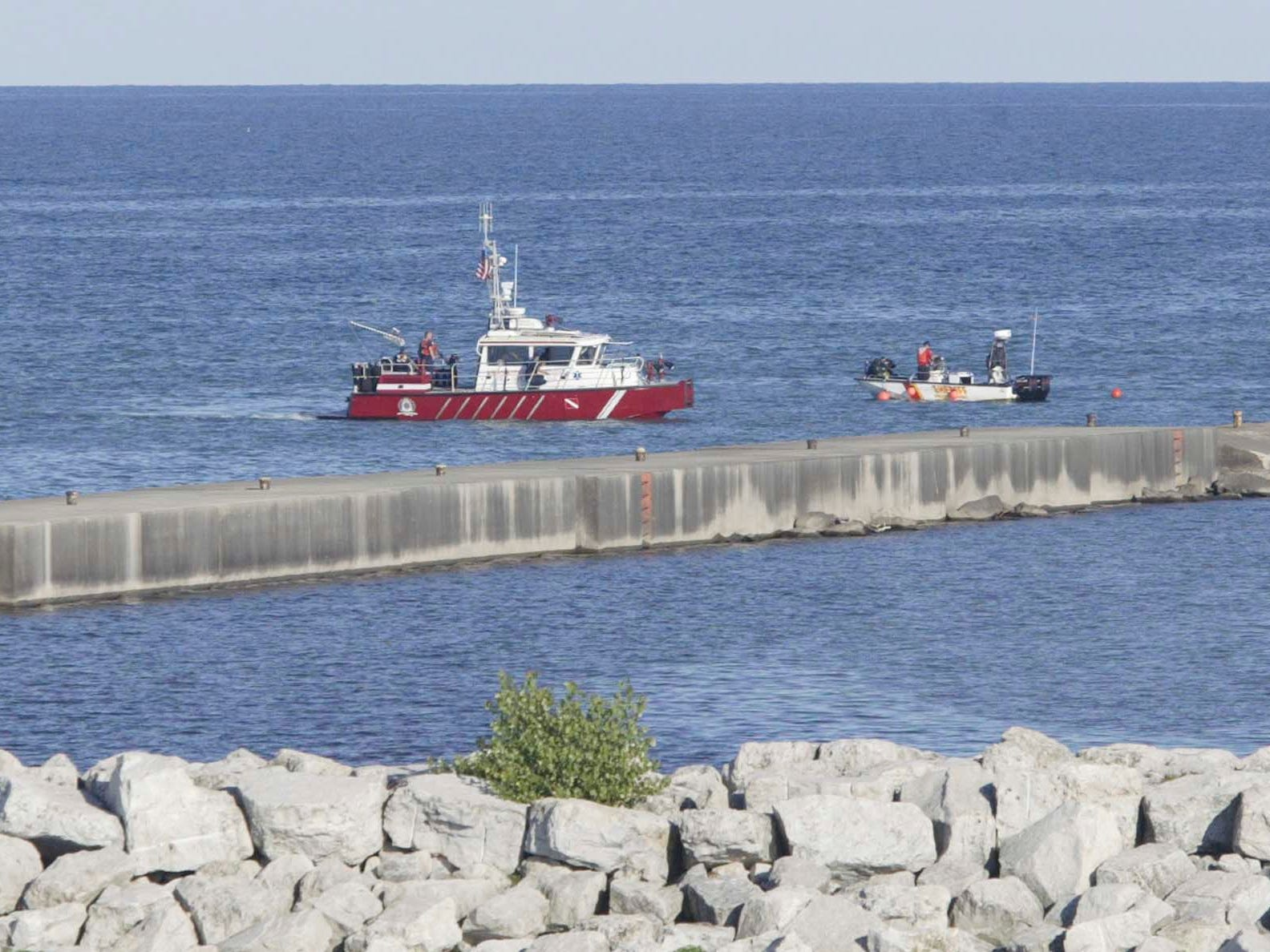 Rescue officials scan the waters of the Sheboygan, Wis., lakefront on Aug. 11, 2008, for John Duong. Duong, 15, of 2623 N. 36th St., was swept underwater by high waves Saturday afternoon while swimming with four friends at North Beach at Deland Park.   FILE PHOTO
