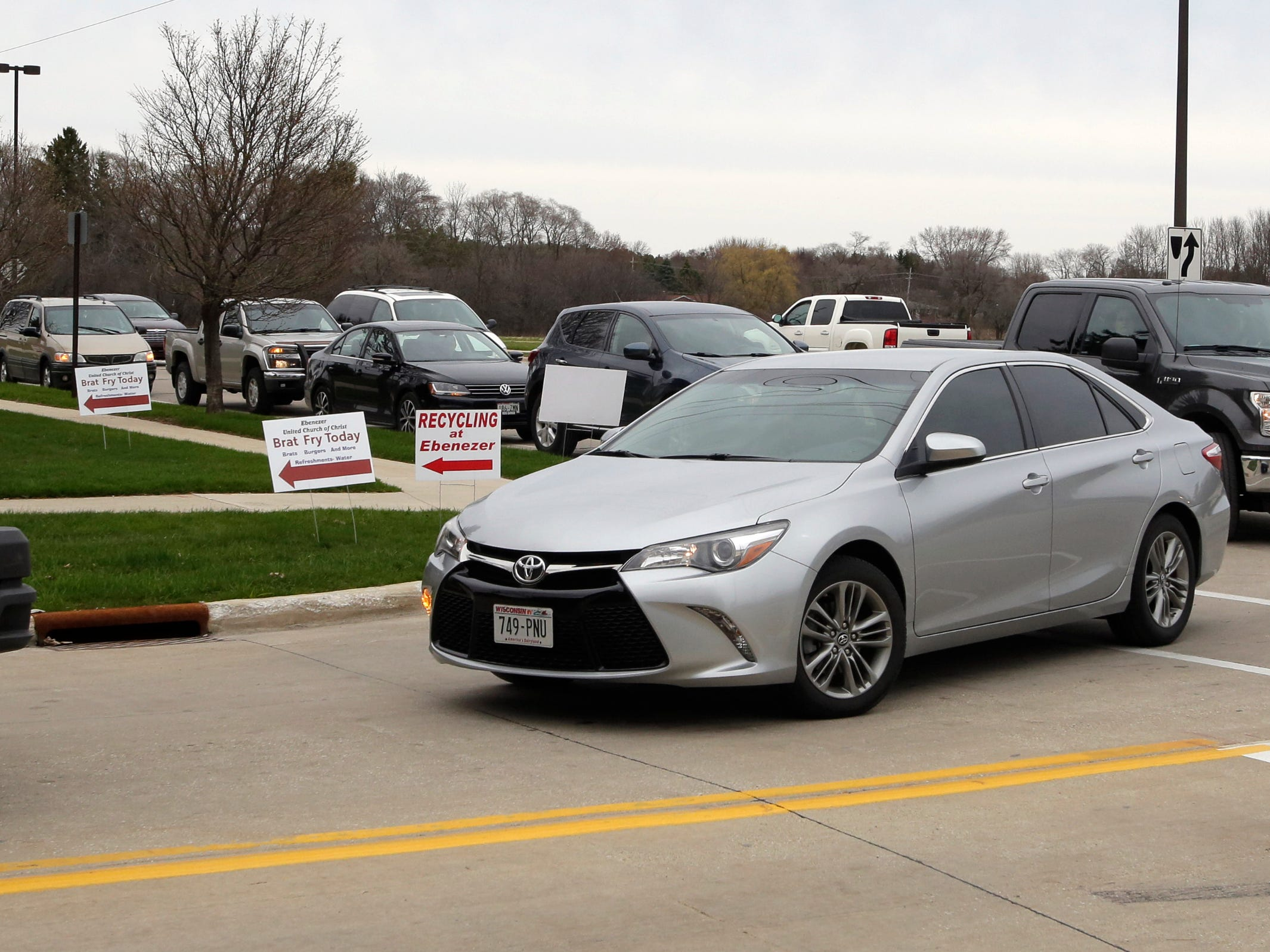 Motorists turn onto Seaman Avenue and line up on Taylor Drive during the recycling event at Ebenezer United Church of Christ, Saturday, April 27, 2019, in Sheboygan, Wis.
