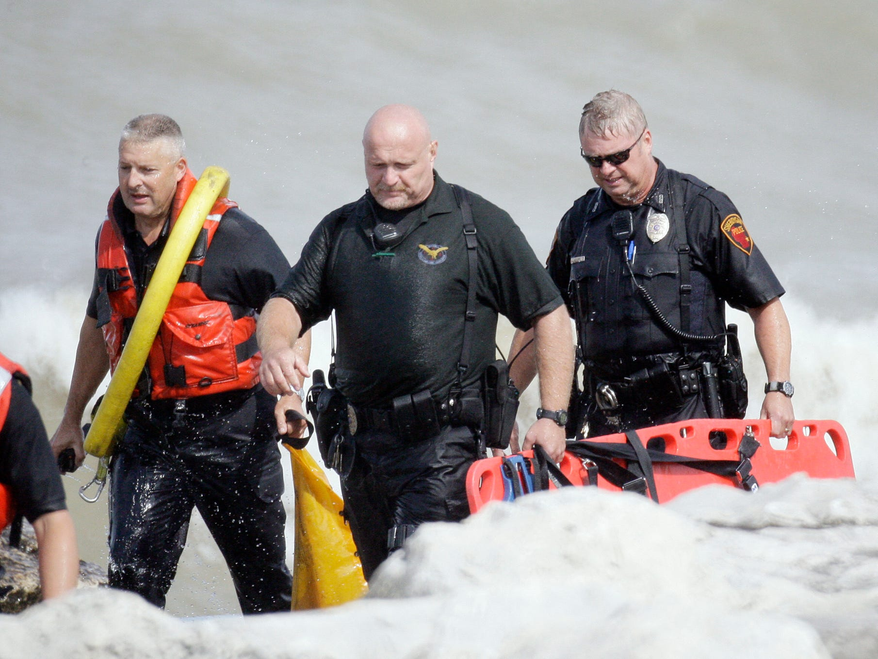Sheboygan police walk back from search operations at North Pier on Aug. 10, 2012, in Sheboygan, WIs.  FILE PHOTO