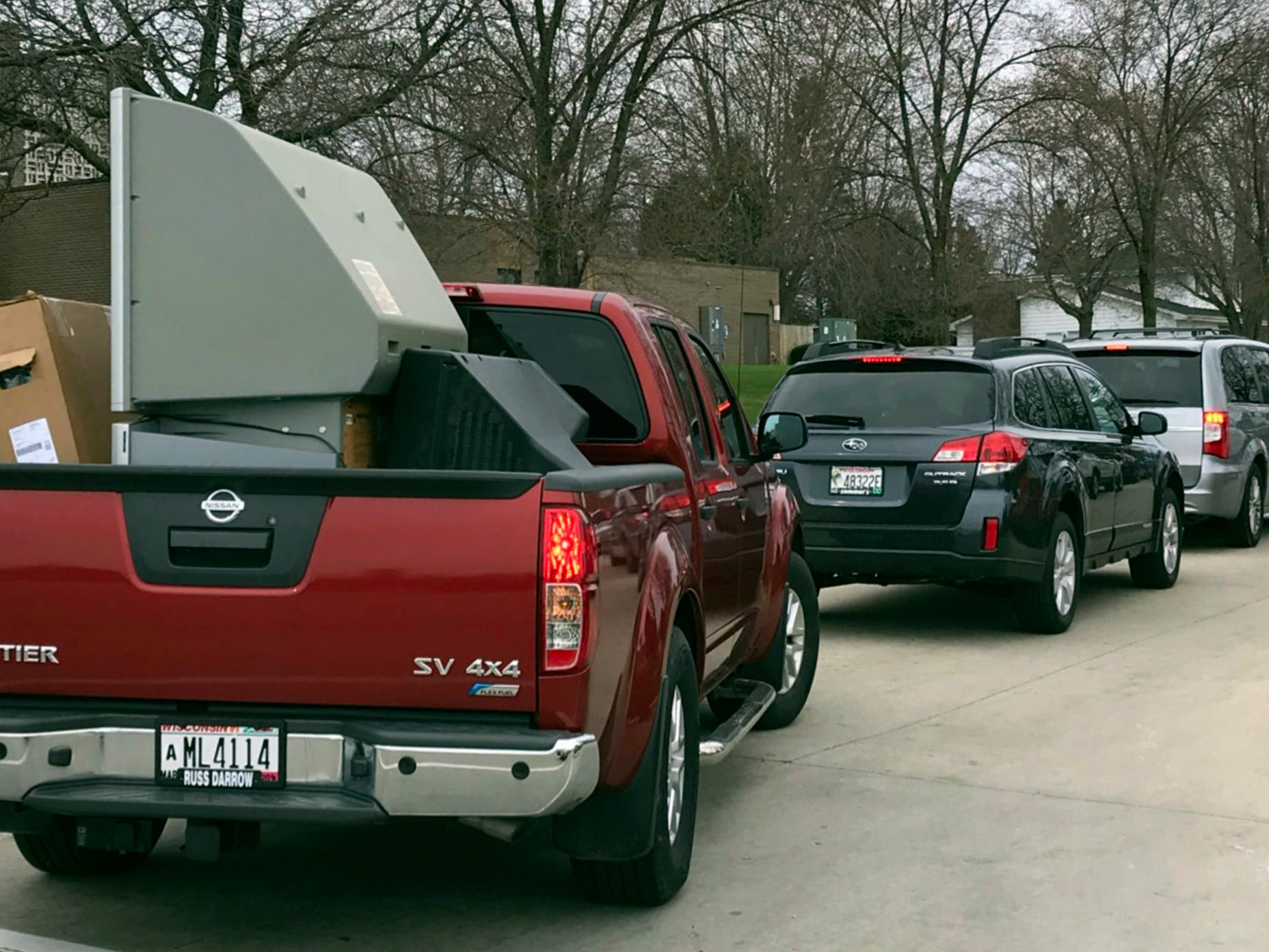 A pickup truck carries a large screen television to be recycled at a recycling event at Ebenezer United Church of Christ, Saturday, April 27, 2019, in Sheboygan, Wis.