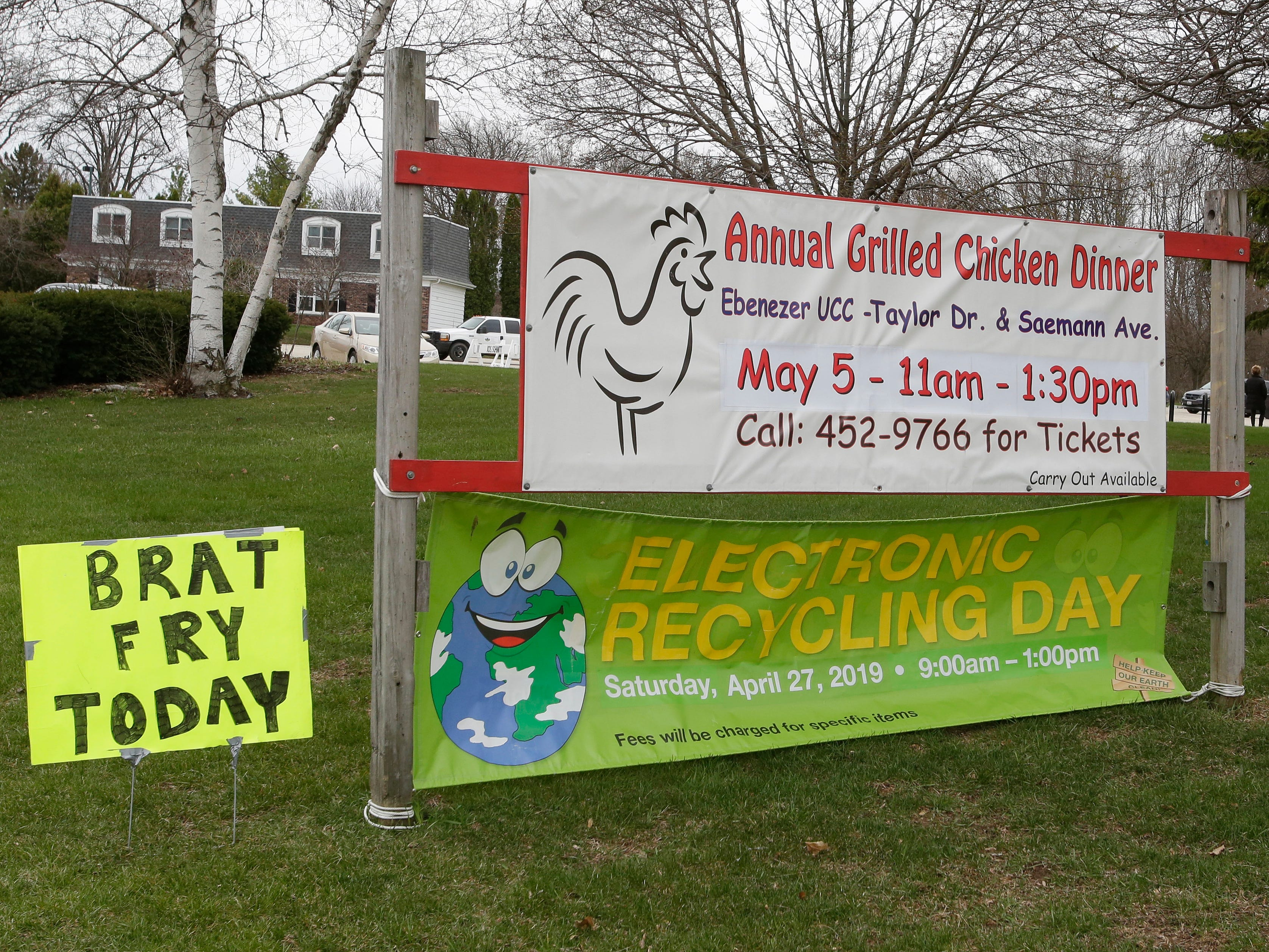 A sign for Electronics Recycling Day at Ebenezer United Church of Christ, Saturday, April 27, 2019, in Sheboygan, Wis. Most items could be just dropped off but some items had a fee for the recycling.