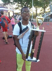 Ruston's Cameron Murphy holds the Bearcats' 5A Region I team track trophy.