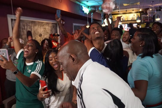 Greedy Williams (back middle) celebrates with his mother, Lakesha Williams Bryant, after hearing his name called during the NFL Draft.