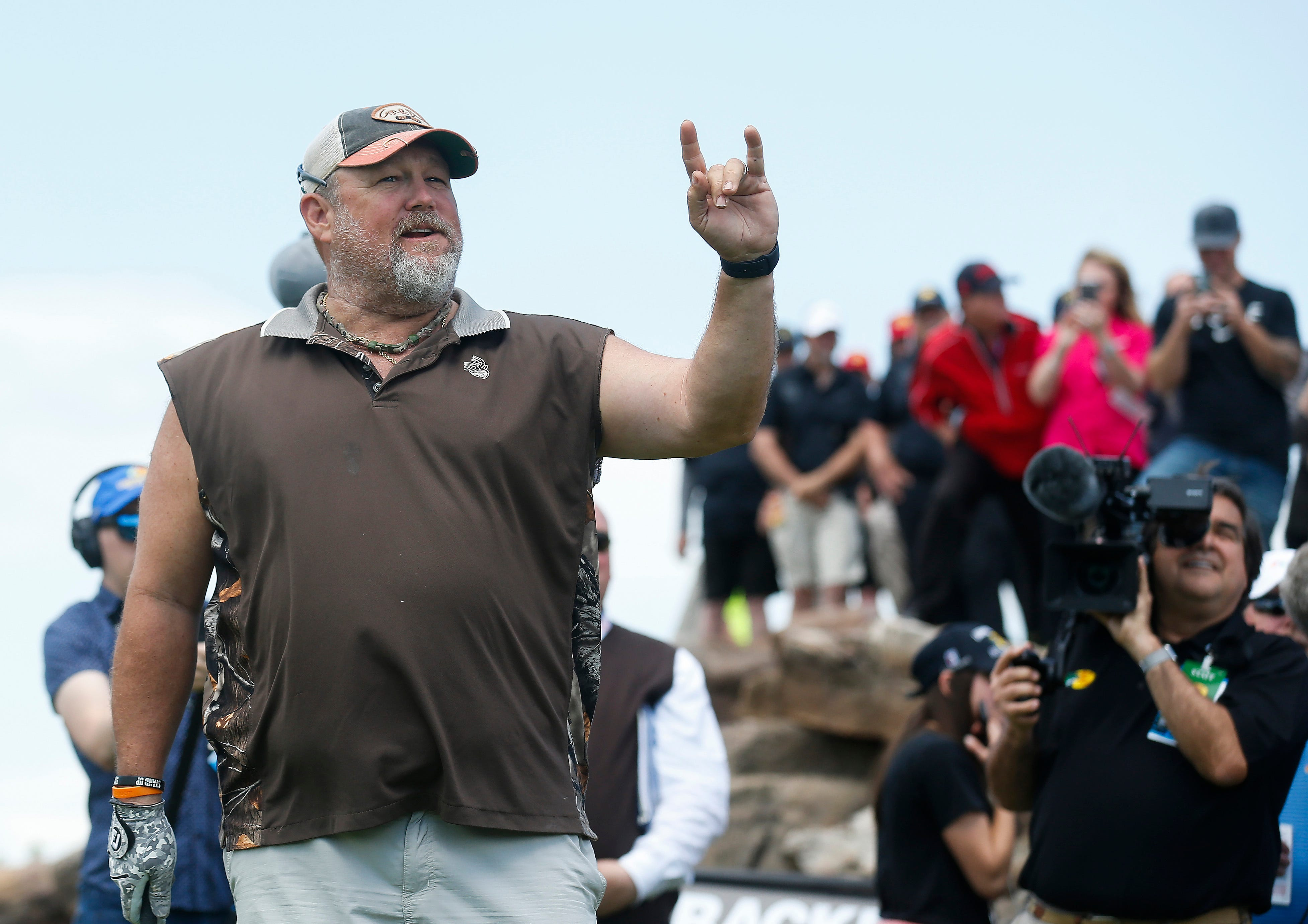 Larry the Cable Guy acknowledges the crowd at the Bass Pro Shops Legends Competition at Top of the Rock on Saturday, April 27, 2019.