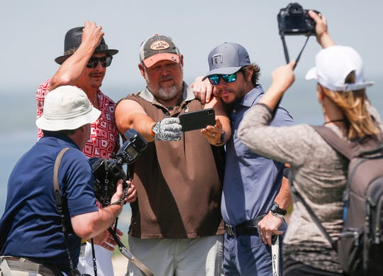 Kid Rock, from left, Larry the Cable Guy and Mark Wahlberg take a selfie at the Bass Pro Shops Legends Competition at Top of the Rock in April.