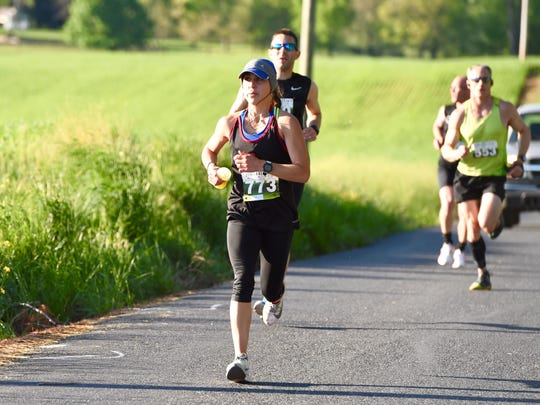 A track star at Lynchburg College in the early 2000s, Ashley Thomasey is now focused on long-distance running. On Saturday, she finished second at the Park to Park Half Marathon.