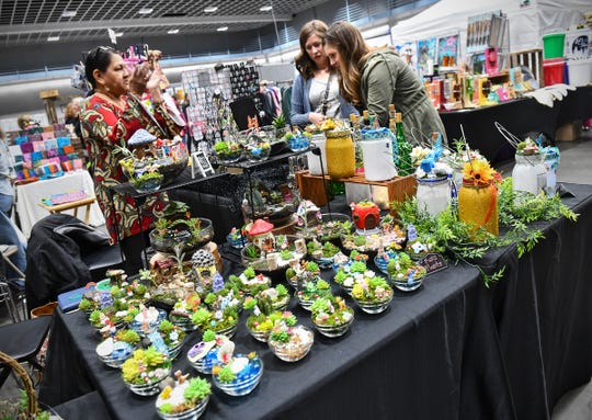 Brightly colored crafts fill a booth during the Midwest Handmade Minnesota Artisan Maker Fair Saturday, April 27, at the River's Edge Convention Center in St. Cloud.