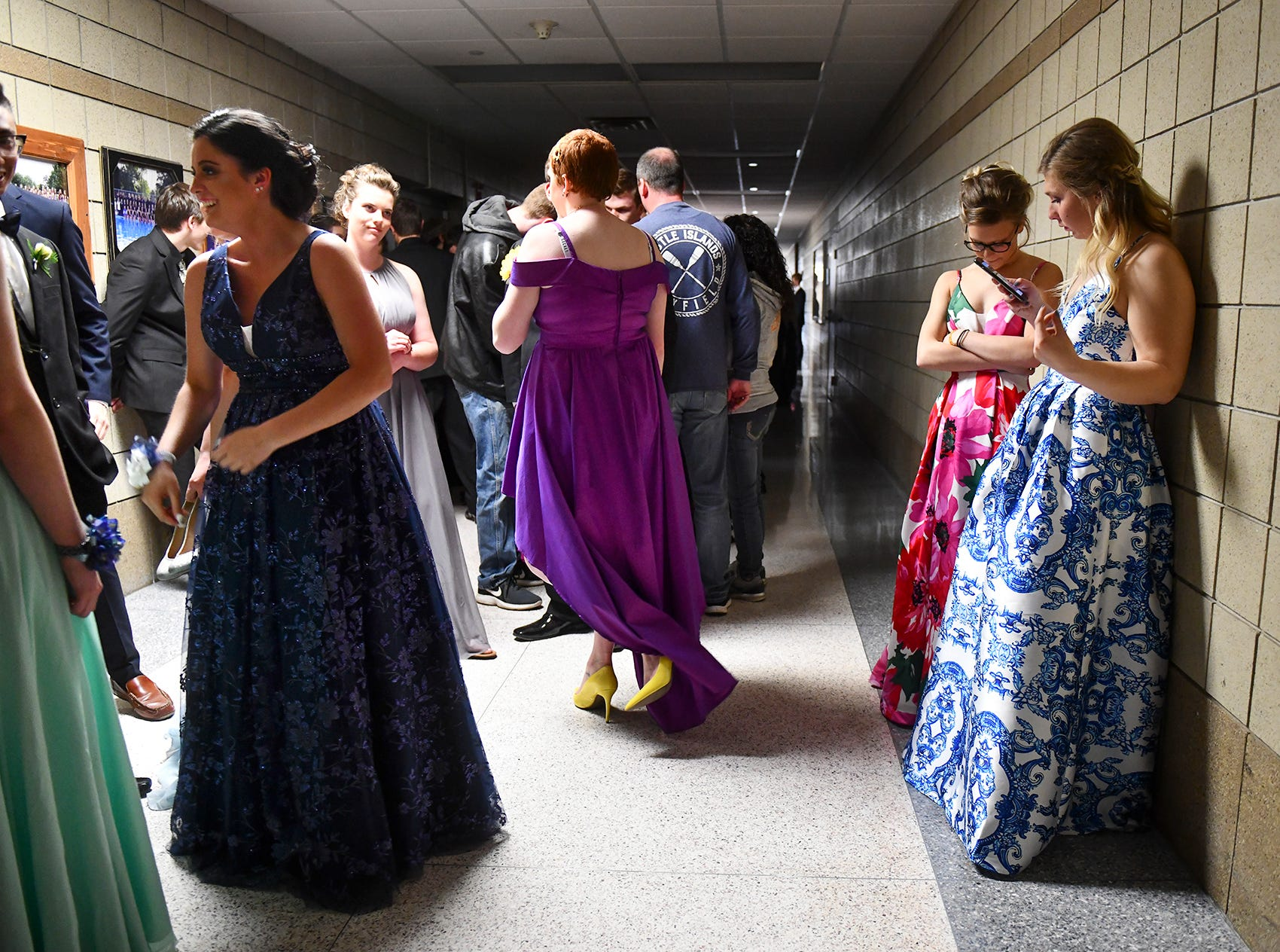 Couples wait their turn for prom grand march Saturday, April 27, at Foley High School.