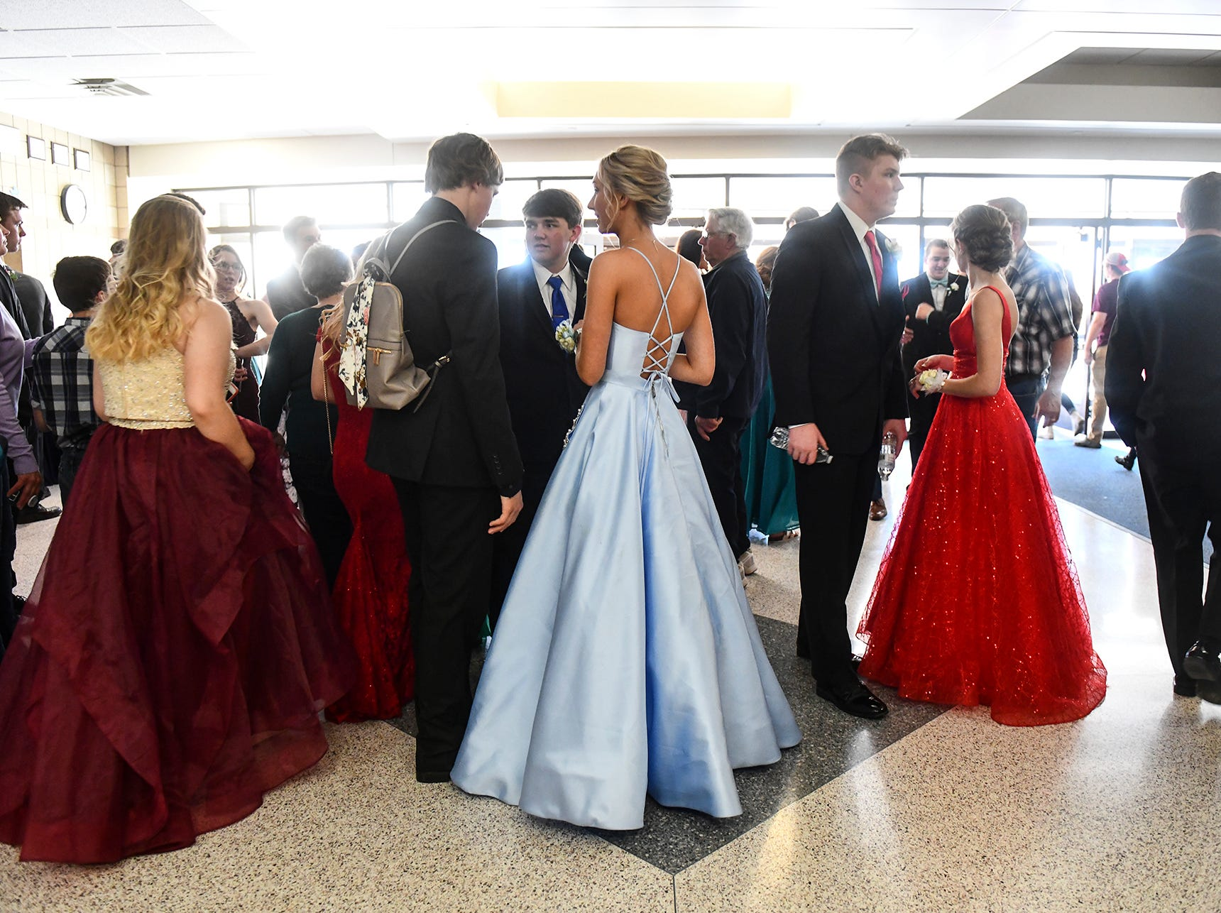 Couples gather after prom grand march Saturday, April 27, at Foley High School.