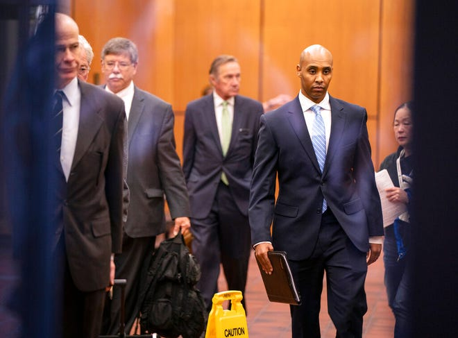 Former Minneapolis police officer Mohamed Noor walks through the elevator lobby of the Hennepin County Government Center with his legal team in Minneapolis on Friday, April 26.