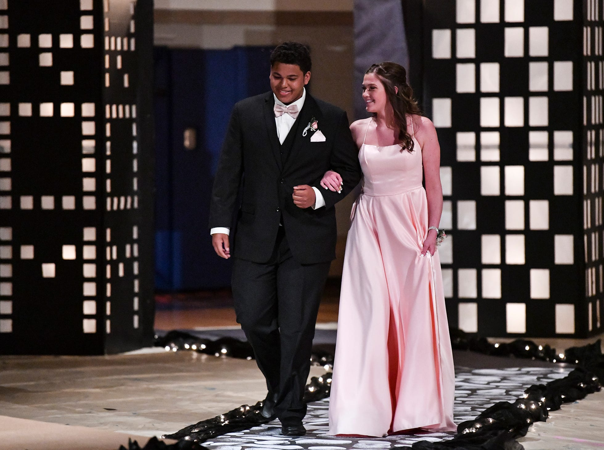 A Couple smiles during prom grand march at Foley High School.