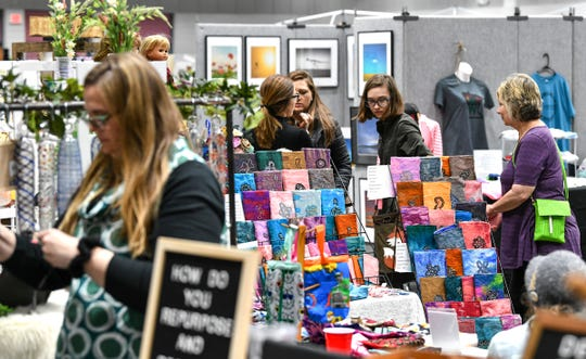 People walk through displays of work by 78 vendors during the Midwest Handmade Minnesota Artisan Maker Fair Saturday, April 27, at the River's Edge Convention Center in St. Cloud.