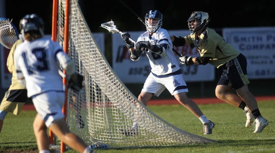 Maclay junior Sam Chase looks for cutters to pass to as Maclay beat Gulf Breeze 18-8 in a lacrosse regional quarterfinal playoff game on April 26, 2019.