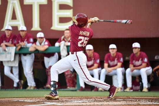 FSU outfielder Robby Martin hits a home run Friday, April 26th against Wake Forest.