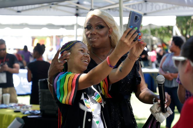 Brittney Gibson, left, takes a selfie with Vashai Avionce. Tallahasseeans celebrate the LGBTQ community during Pride in the Plaza Saturday, April 27, 2019.