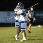 Maclay's Matthew Winegardner (6) celebrates his goal with Stone Foster as Maclay beat Gulf Breeze 18-8 in a lacrosse regional quarterfinal playoff game on April 26, 2019.
