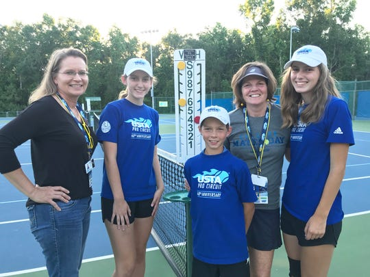 From left to right: Pia Neustadter (volunteer coordinator), Lily Dennis, Gabe Garcia, Elizabeth Adkison Seay (volunteer coordinator) and Chloe Dennis worked throughout the week at the Tallahassee Tennis Challenger. The Dennis twins and Garcia volunteered as ball girls/boy.