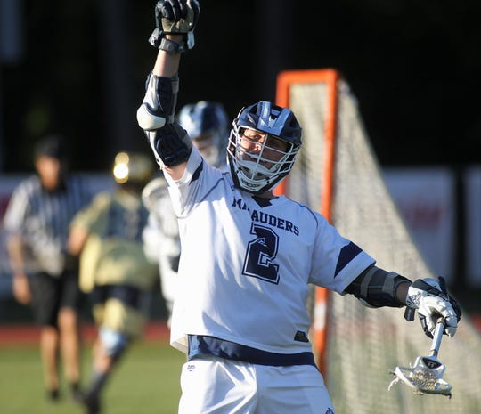 Maclay junior Sam Chase celebrates an assisted goal to Carson Rowe as Maclay beat Gulf Breeze 18-8 in a lacrosse regional quarterfinal playoff game on April 26, 2019.
