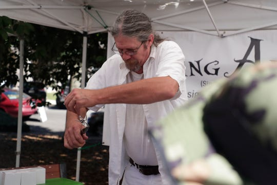 Greg Beck, an artist who creates sculptures from forks, demonstrates his craft. Art lovers enjoy the work of fine art painters, photographers, sculptors and other unique artists at the LeMoyne Chain of Parks Art Festival Saturday, April 27, 2019.