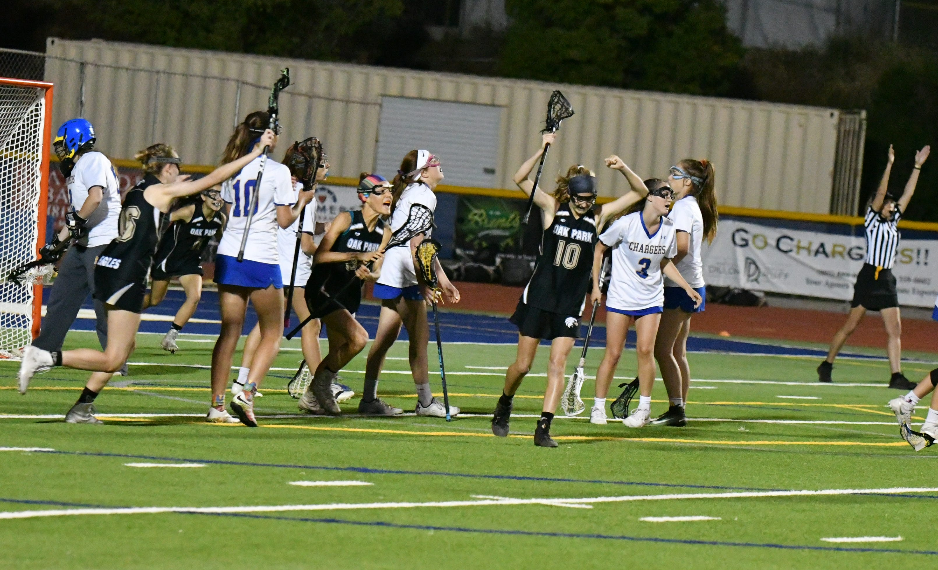 Oak Park senior Erin Dotson, center, celebrates scoring the winning goal with three seconds in overtime of the inaugural Coastal Canyon League girls lacrosse championship tournament.