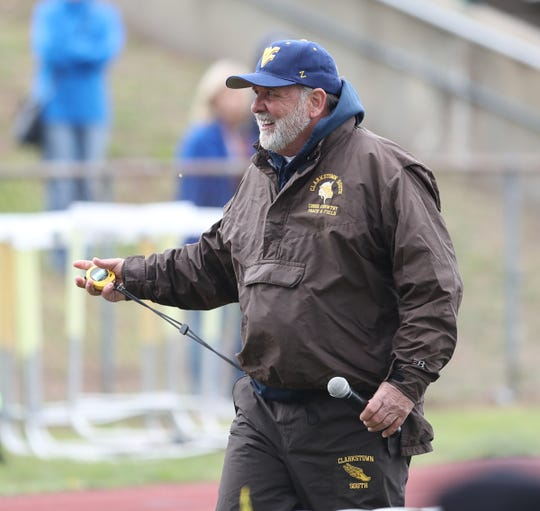 Clarkstown South track & field coach Ray Kondracki works the startingline at the Gold Rush Invitational track & field meet at Clarkstown South High School in West Nyack on Saturday, April 27, 2019.
