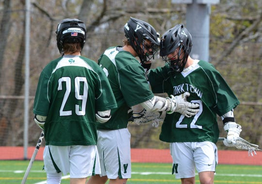 Yorktown's Reese Alexander (22) congratulates Alex DeBenedictis following a goal at Somers on Saturday, April 27, 2019.