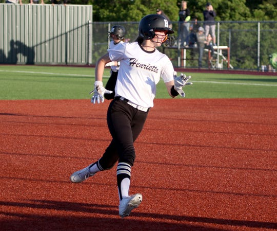 Henrietta's Haleigh Hogan runs to third in the game against Jacksboro Friday, April 26, 2019, in Bowie. The Lady Cats defeated the Lady Tigers 13-4.
