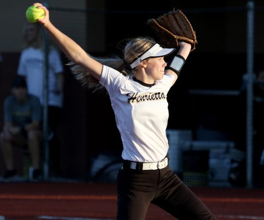 Henrietta's Haleigh Hogan pitches against Jacksboro Friday, April 26, 2019, in Bowie. The Lady Cats defeated the Lady Tigers 13-4.