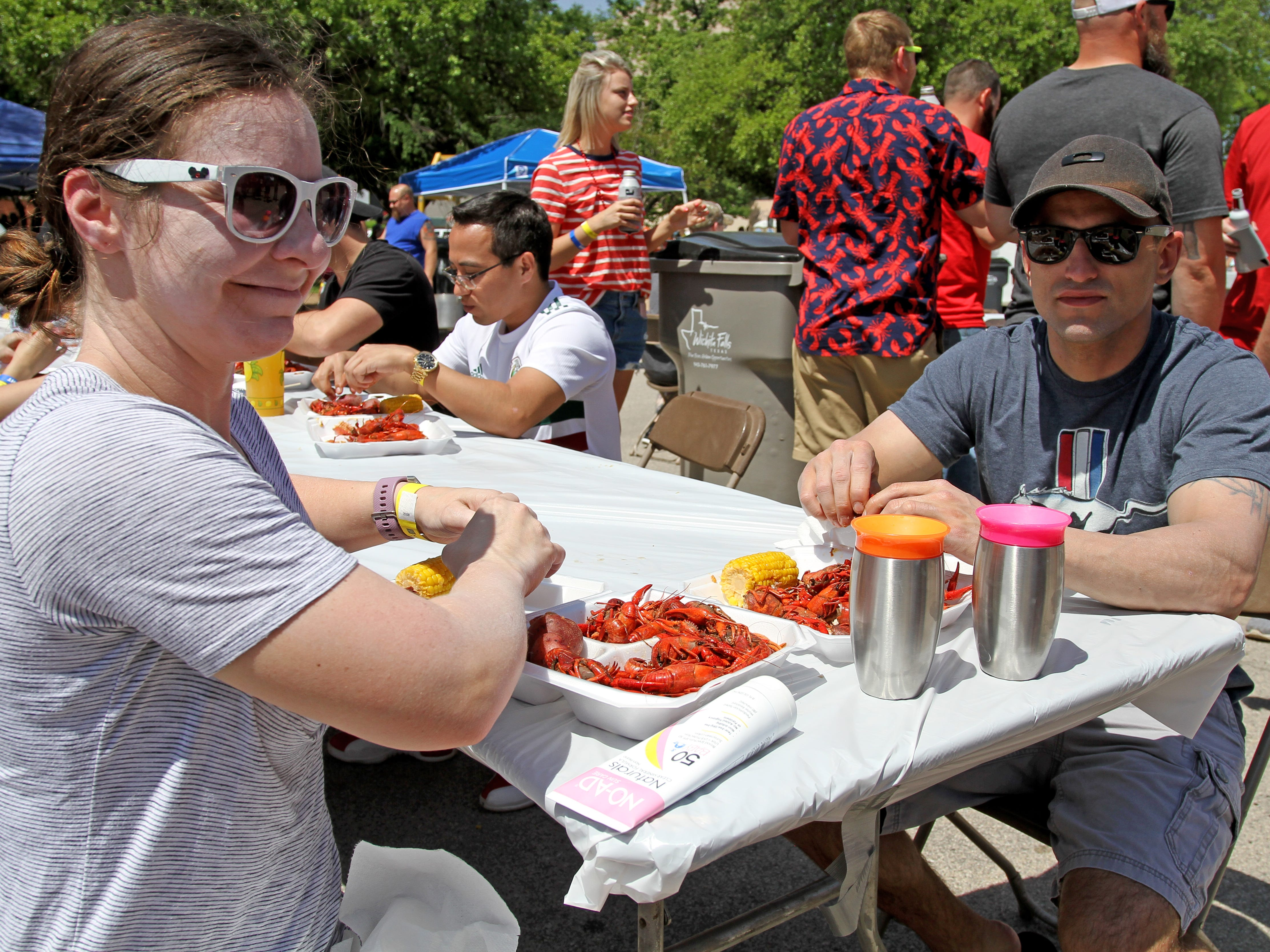 Emily, left, and Derek McLemore eat crawfish at Cajun Fest Saturday, April 27, 2019, at 10th and Ohio downtown. The McLemore's are from Louisana and said it's great to have a taste of home.