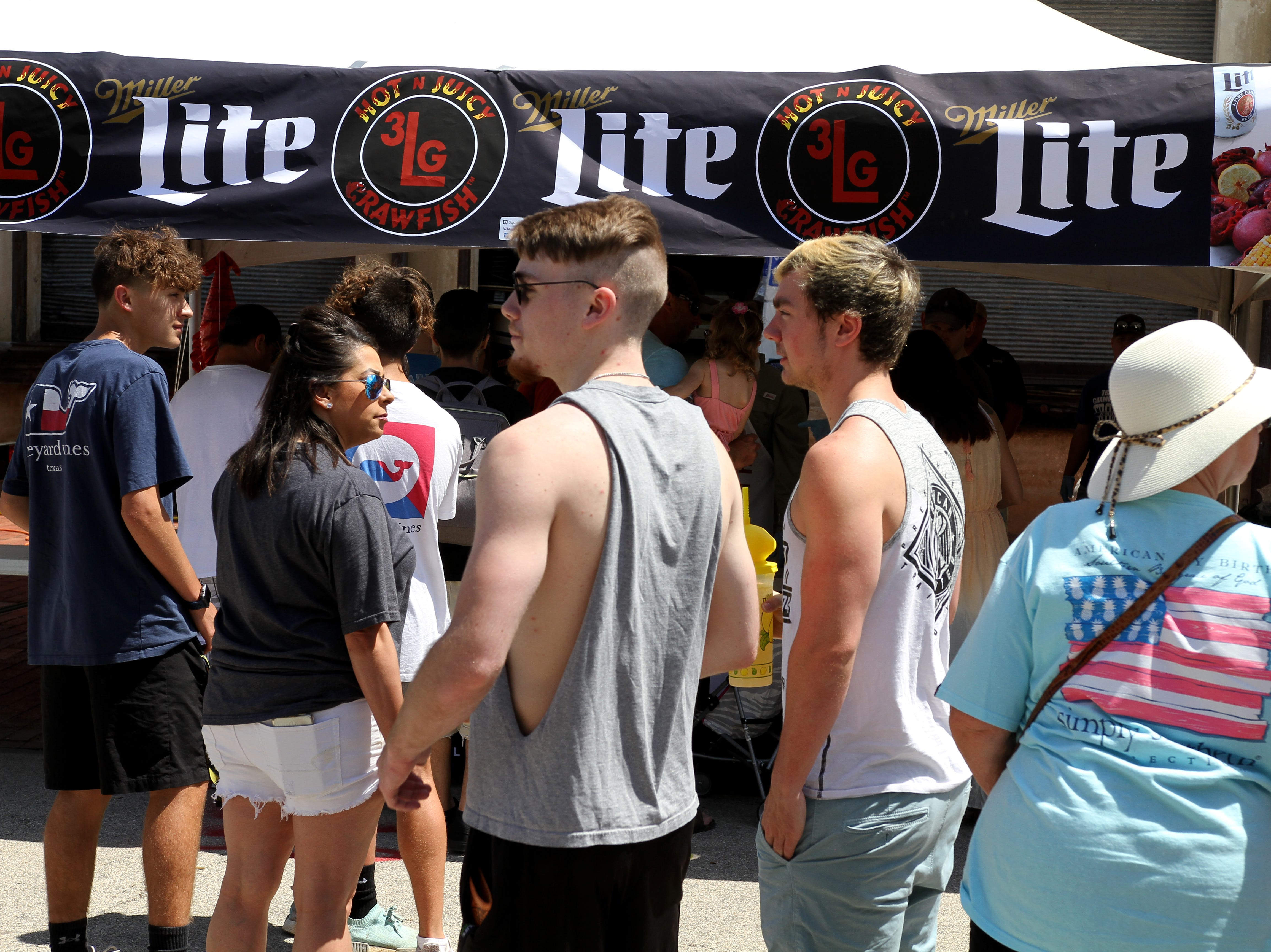 People stand in line for crawfish at Cajun Fest Saturday, April 27, 2019, at 10th and Ohio downtown.