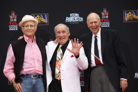 Carl Reiner, right, joined friends Norman Lear, left, and Mel Brooks for Brooks' 2014 hand and footprint ceremony at TCL Chinese Theater in Hollywood. Look closely, as cut-up Brooks added a prosthetic finger to his left hand to make an extra impression.