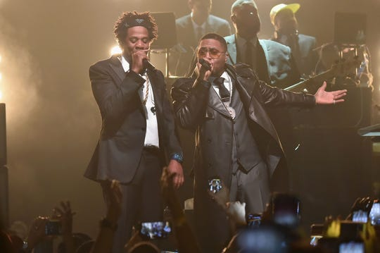 """Rappers Jay-Z, left, and Nas performed """"New York State of Mind"""" and other songs together Friday night."""