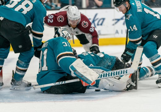 Second round: Sharks goaltender Martin Jones makes a save against Avalanche left wing Gabriel Landeskog during the second period of Game 1.