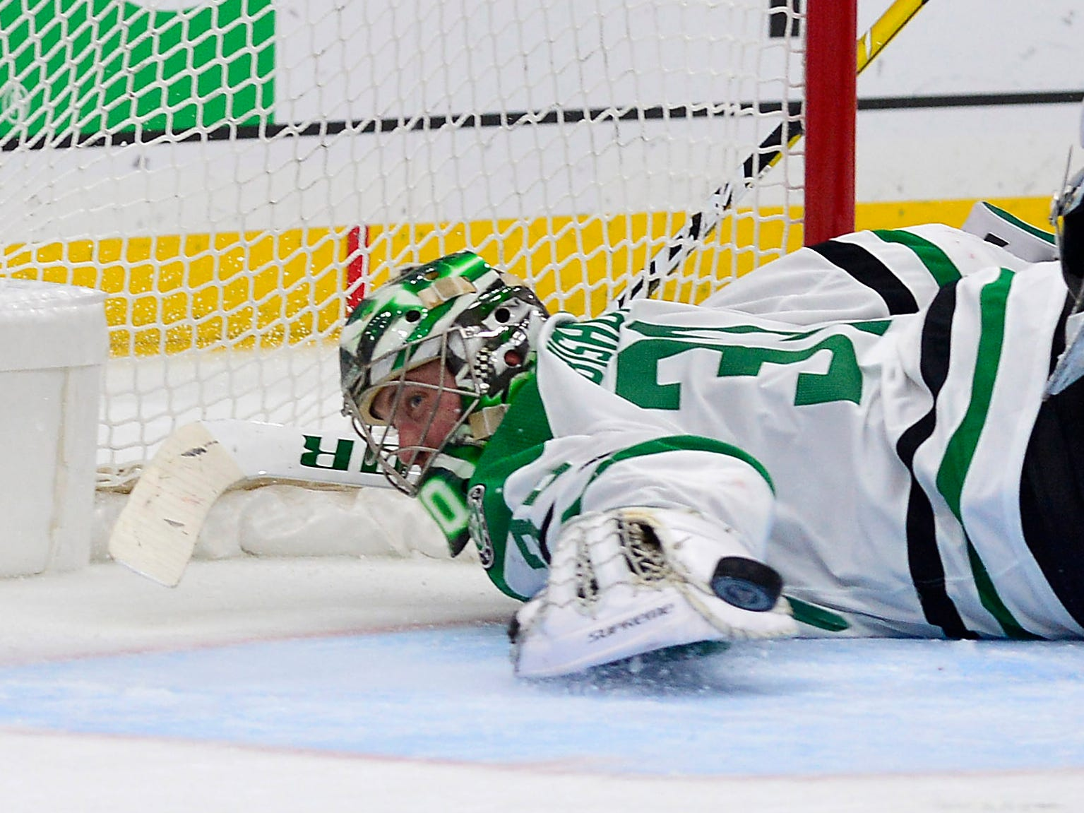 Second round: Stars goaltender Ben Bishop deflects the puck away from the net during the second period in Game 2 against the Blues.