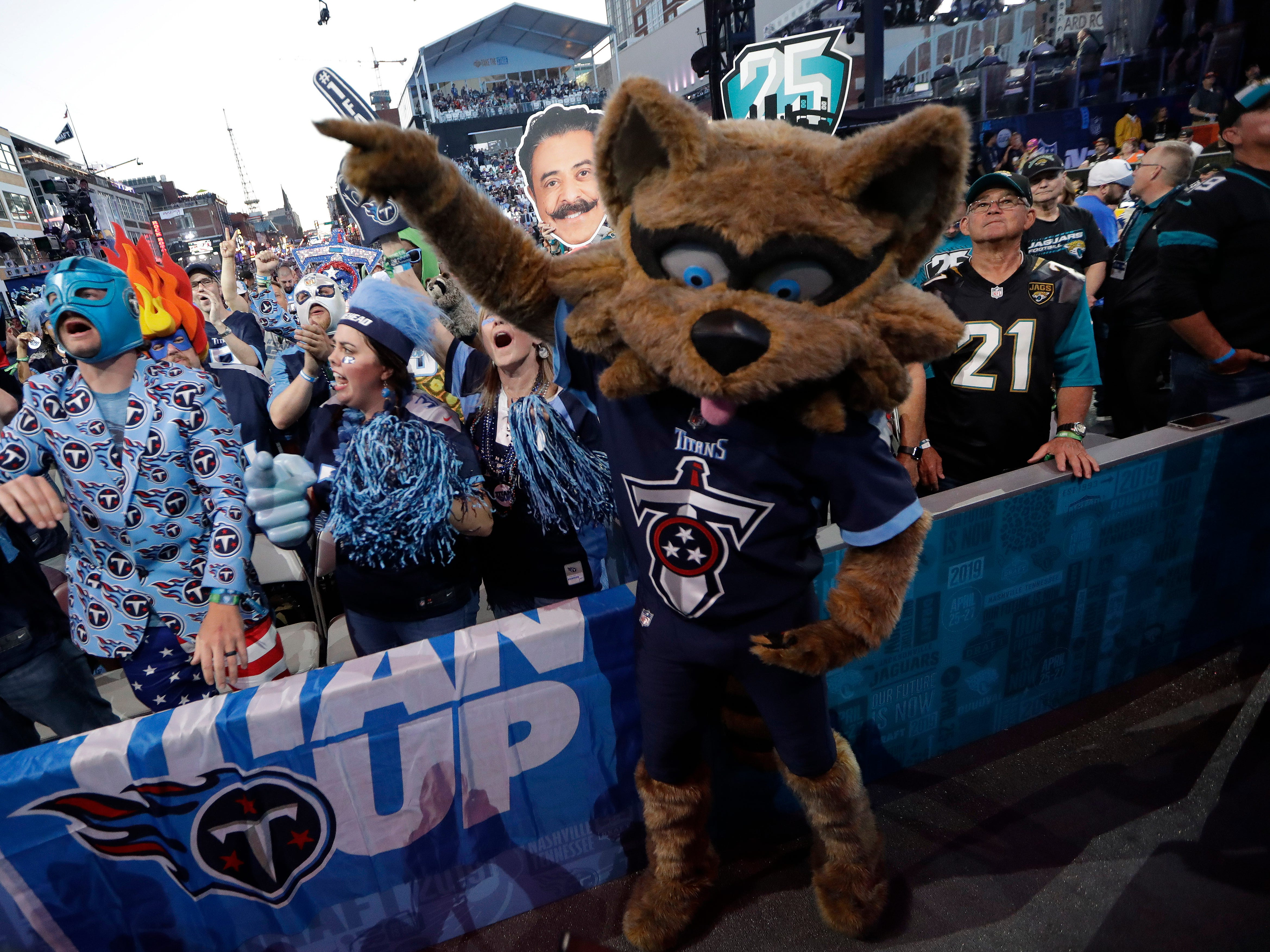 Tennessee Titans mascot cheers with fans near the main stage during the second round of the draft.