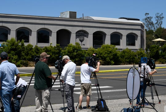 Television cameras film the outside of the Chabad of Poway Synagogue Saturday, April 27, 2019, in Poway, Calif. Several people were injured in a shooting at the synagogue.