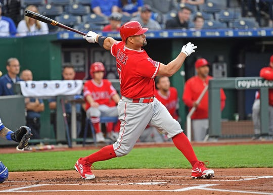 Albert Pujols (5) hits a two-run home run in the first inning.