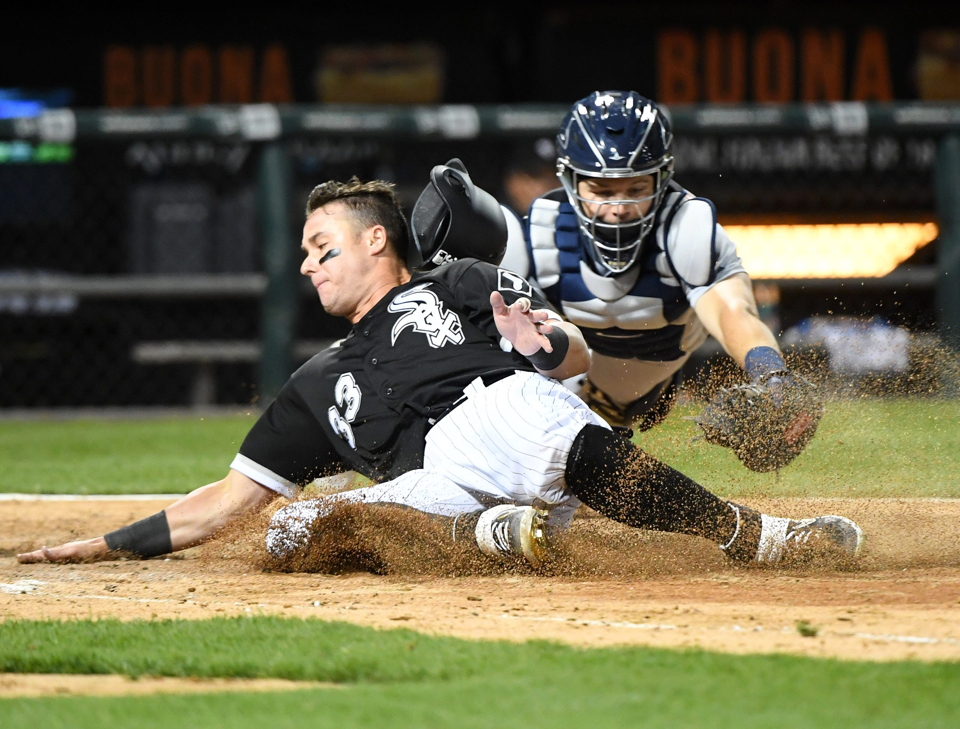 April 26: The Chicago White Sox's James McCann slides home in front of the tag of Detroit Tigers catcher Grayson Greiner during the fifth inning at Guaranteed Rate Field. The White Sox won the game, 12-11.