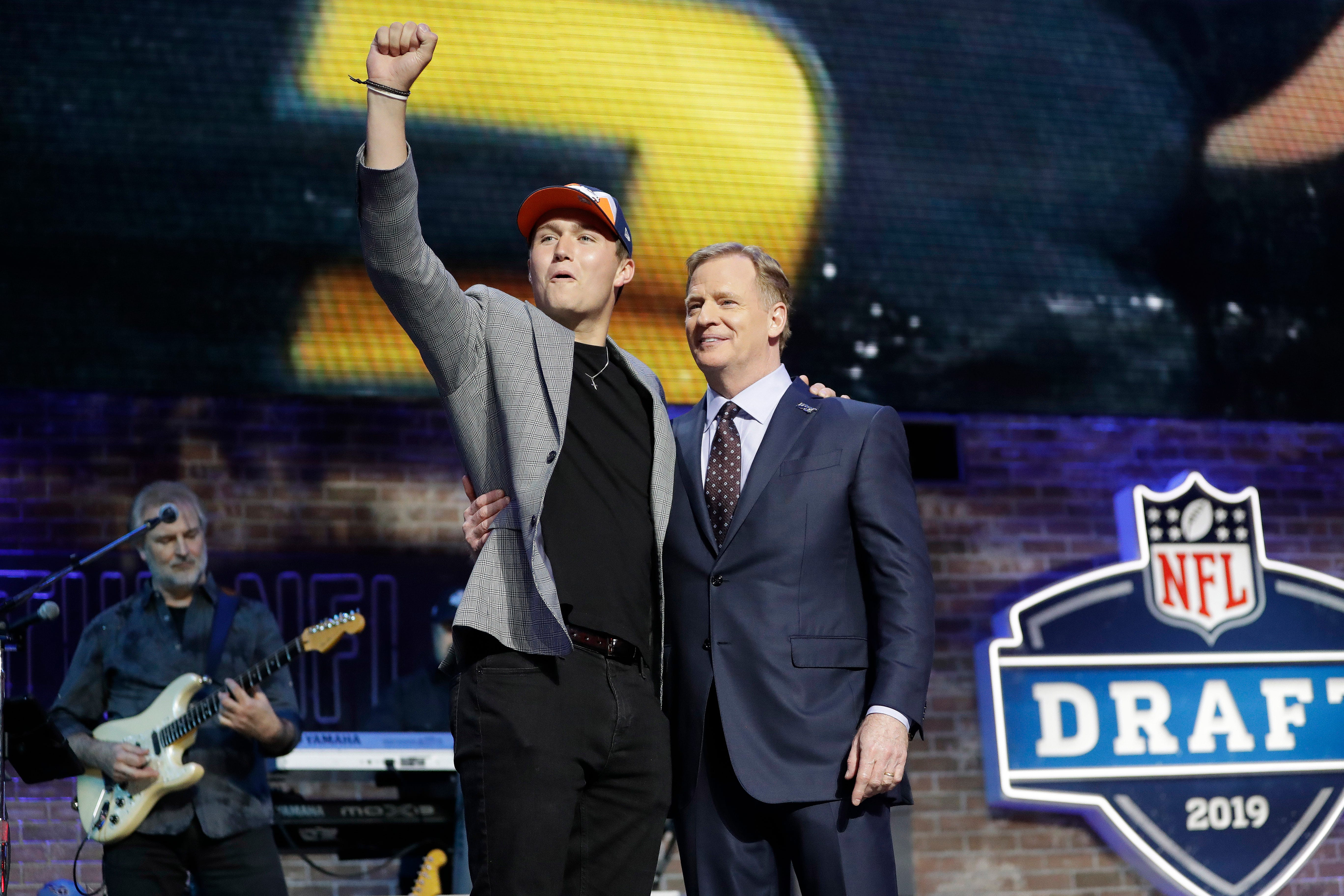 Missouri quarterback Drew Lock poses with NFL commissioner Roger Goodell after the Denver Broncos selected Lock in the second round.
