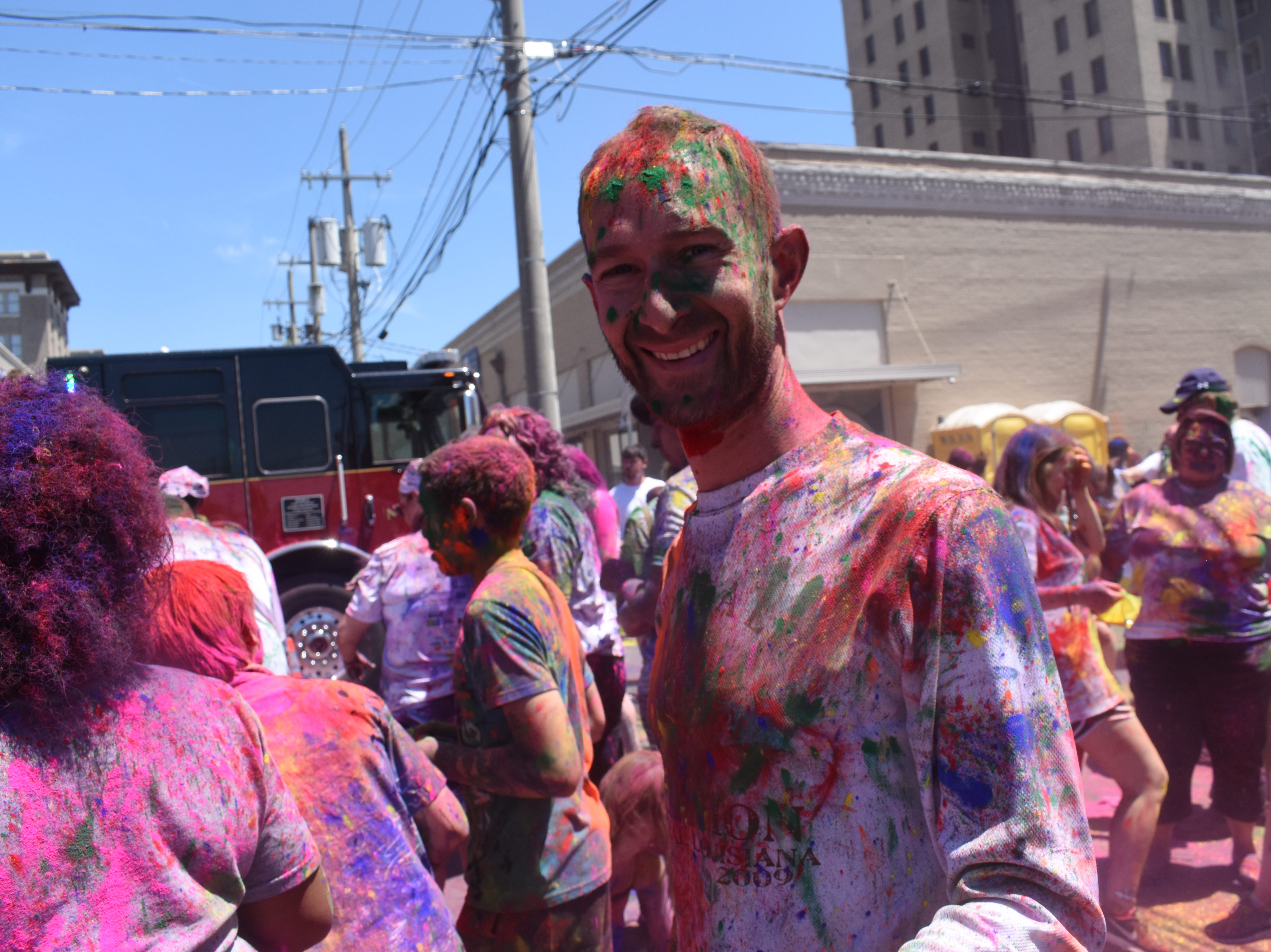 In association with the Children's Advocacy Network, the Cenla India Association hosted the eighth annual Holi-Fest 2019 - the Festival of Colors - in downtown Alexandria near Tamp & Grind Coffee House on 4th Street on Saturday, April 27, 2019. A 4K run and walk were also held. Plate lunches of Indian cuisine were also sold. Proceeds benefit the Children's Advocacy Network which has the goal that every child lives in a safe, permanent home, free of abuse and neglect. The event, in which participants toss powdered color at each other, has become one of Alexandria's popularÊevents.Holi-Fest originated in Northern India about 3,000 years ago as a celebration to welcome the spring. Festival-goers toss powdered colors at each other as they celebrate.